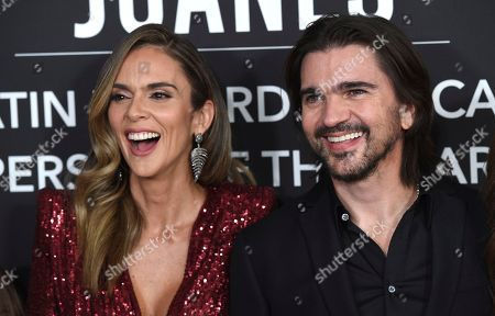 Juanes, Karen Martinez. Juanes, right, and Karen Martinez arrive at the Latin Recording Academy Person of the Year gala in his honor at the MGM Conference Center, in Las Vegas