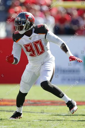 Tampa Bay Buccaneers defensive end Jason Pierre-Paul (90) rushes in against the Arizona Cardinals during an NFL football game, in Tampa, Fla. The Buccaneers won the game 30-27