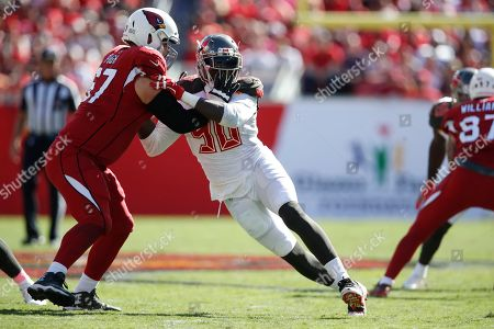 Jason Pierre-Paul, Justin Pugh. Tampa Bay Buccaneers defensive end Jason Pierre-Paul (90) rushes in Arizona Cardinals offensive guard Justin Pugh (67) during an NFL football game, in Tampa, Fla. The Buccaneers won the game 30-27