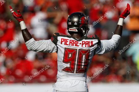 Tampa Bay Buccaneers defensive end Jason Pierre-Paul (90) celebrates a stop against the Arizona Cardinals during an NFL football game, in Tampa, Fla. The Buccaneers won the game 30-27