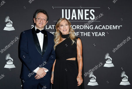 President and CEO of the Latin Academy of Recording Arts & Sciences (LARAS) Gabriel Abaroa Jr. (L) and US music executive Deborah Dugan (R) arrive for the 2019 Latin Recording Academy Person of the Year gala at the MGM Grand Conference Center in Las Vegas, Nevada, USA, 13 November 2019. The event precedes the 20th annual Latin Grammy Awards that recognize artistic and/or technical achievement, not sales figures or chart positions, and the winners are determined by the votes of their peers - the qualified voting members of the Latin Recording Academy.