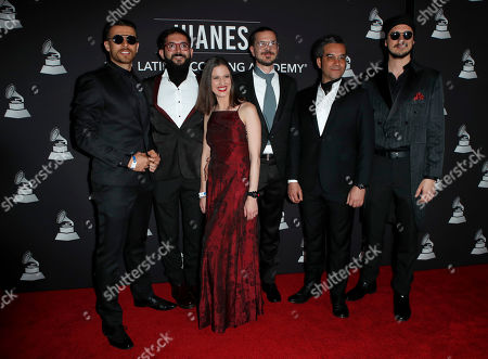 Stock Photo of Tomas Pinzon, Pablo Munoz Barragan, Diana Osorio, Olivier Lestriez, Javier Ojeda and Francisco Marti of Burning Caravan arrive for the 2019 Latin Recording Academy Person of the Year gala at the MGM Grand Conference Center in Las Vegas, Nevada, USA, 13 November 2019. The event precedes the 20th annual Latin Grammy Awards that recognize artistic and/or technical achievement, not sales figures or chart positions, and the winners are determined by the votes of their peers - the qualified voting members of the Latin Recording Academy.