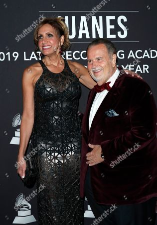 Lili Estefan (L) and US-Cuban television personality Raul De Molina (R) arrive for the 2019 Latin Recording Academy Person of the Year gala at the MGM Grand Conference Center in Las Vegas, Nevada, USA, 13 November 2019. The event precedes the 20th annual Latin Grammy Awards that recognize artistic and/or technical achievement, not sales figures or chart positions, and the winners are determined by the votes of their peers - the qualified voting members of the Latin Recording Academy.