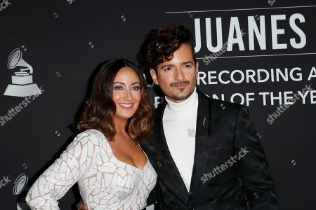 Puerto Rican actress Karla Monroig (L) and Puerto Rican singer-songwriter Tommy Torres (R) arrive for the 2019 Latin Recording Academy Person of the Year gala at the MGM Grand Conference Center in Las Vegas, Nevada, USA, 13 November 2019. The event precedes the 20th annual Latin Grammy Awards that recognize artistic and/or technical achievement, not sales figures or chart positions, and the winners are determined by the votes of their peers - the qualified voting members of the Latin Recording Academy.