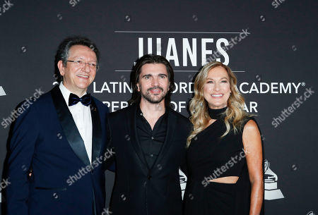 President and CEO of the Latin Academy of Recording Arts & Sciences (LARAS) Gabriel Abaroa Jr. (L), Colombian musician Juanes (C), and US music executive Deborah Dugan (R) arrive for the 2019 Latin Recording Academy Person of the Year gala at the MGM Grand Conference Center in Las Vegas, Nevada, USA, 13 November 2019. The event precedes the 20th annual Latin Grammy Awards that recognize artistic and/or technical achievement, not sales figures or chart positions, and the winners are determined by the votes of their peers - the qualified voting members of the Latin Recording Academy.