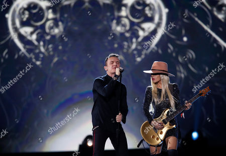 Colombian singer Fonseca (L) and Australian musician Orianthi (R) perform during the 2019 Latin Recording Academy Person of the Year gala at the MGM Grand Conference Center in Las Vegas, Nevada, USA, 13 November 2019. The event precedes the 20th annual Latin Grammy Awards that recognize artistic and/or technical achievement, not sales figures or chart positions, and the winners are determined by the votes of their peers - the qualified voting members of the Latin Recording Academy.