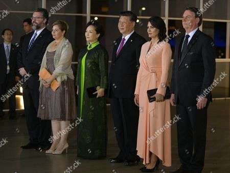 Brazilian Foreign Minister Ernesto Araujo (L) with his wife Maria Eduarda de Seixas Correa (2-L), Chinese President Xi Jinping (3-R) with his wife Peng Liyuan (3-L) and Brazilian President Jair Bolsonaro (R) with his wife Michelle Bolsonaro (2-R) pose for a picture before a concert at the Ministry of Foreign Affairs in Brasilia, Brazil, 13 November 2019. Xi Jinping is in Brazil to attend the 11th Brazil, Russia, India, China and South Africa (BRICS) Business Forum.