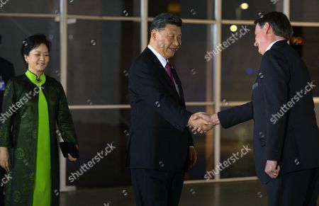 Brazilian President Jair Bolsonaro (R) welcomes Chinese President Xi Jinping (C) with his wife Peng Liyuan (L) at a concert at the Ministry of Foreign Affairs in Brasilia, Brazil, 13 November 2019. Xi Jinping is in Brazil to attend the 11th Brazil, Russia, India, China and South Africa (BRICS) Business Forum.