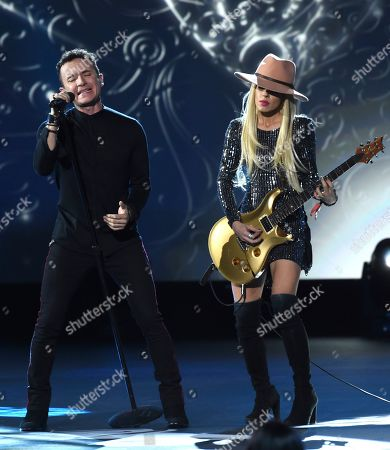 """Fonseca, Orianthi. Fonseca, left, and Orianthi perform """"Nada Valgo Sin Tu Amor"""" at the Latin Recording Academy Person of the Year gala honoring Juanes at the MGM Conference Center, in Las Vegas"""