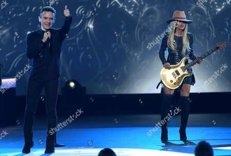 """Stock Picture of Fonseca, Orianthi. Fonseca, left, and Orianthi perform """"Nada Valgo Sin Tu Amor"""" at the Latin Recording Academy Person of the Year gala honoring Juanes at the MGM Conference Center, in Las Vegas"""