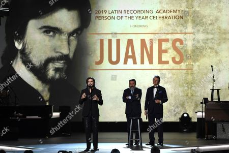 Juanes, Gabriel Abaroa, Jesus Lopez. Juanes accepts his award at the Latin Recording Academy Person of the Year gala in his honor at the MGM Conference Center, in Las Vegas. Looking on from right are Gabriel Abaroa, president and CEO of the Latin Recording Academy, and Jesus Lopez, Universal Music LATAM Chairman
