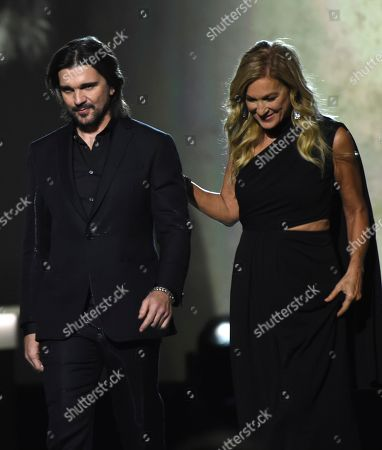 Juanes, Deborah Dugan. Recording Academy President Deborah Dugan, right, and honoree Juanes, walk off stage at the Latin Recording Academy Person of the Year gala honoring Juanes at the MGM Conference Center, in Las Vegas
