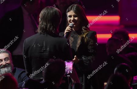 """Stock Picture of Juanes, left, and Paula Fernandes appear in the audience after her performance of """"Para Tu Amor"""" at the Latin Recording Academy Person of the Year gala honoring Juanes at the MGM Conference Center, in Las Vegas"""