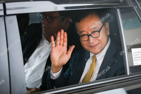 Self-exiled former Cambodian opposition leader Sam Rainsy waves to the media upon arriving at Soekarno-Hatta airport in Jakarta, Indonesia, 14 November 2019. Rainsy is in Jakarta to meet with Indonesian parliament members. Sam Rainsy, former leader of Cambodia's largest opposition party, the Cambodia National Rescue Party, chose self-imposed exile for a second time in 2016, in order to avoid a series of convictions he says are politically motivated.