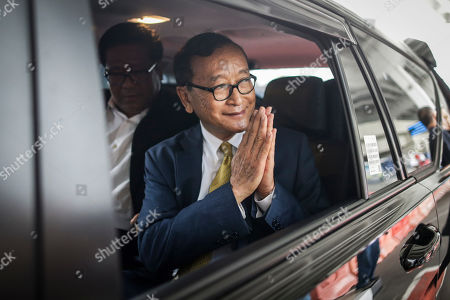 Stock Photo of Self-exiled former Cambodian opposition leader Sam Rainsy greets media upon arriving at Soekarno-Hatta airport in Jakarta, Indonesia, 14 November 2019. Rainsy is in Jakarta to meet with Indonesian parliament members. Sam Rainsy, former leader of Cambodia's largest opposition party, the Cambodia National Rescue Party, chose self-imposed exile for a second time in 2016, in order to avoid a series of convictions he says are politically motivated.