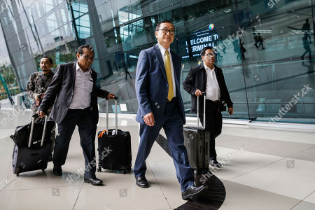 Self-exiled former Cambodian opposition leader Sam Rainsy (C) and other Cambodia National Rescue Party (CNRP) members arrive at Soekarno-Hatta airport in Jakarta, Indonesia, 14 November 2019. Rainsy is in Jakarta to meet with Indonesian parliament members. Sam Rainsy, former leader of Cambodia's largest opposition party, the Cambodia National Rescue Party, chose self-imposed exile for a second time in 2016, in order to avoid a series of convictions he says are politically motivated.