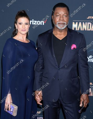 Stock Photo of Carl Weathers and Christine Kludjian