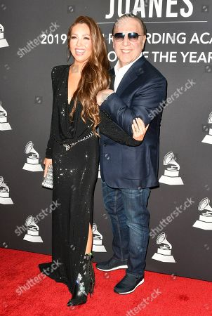 Thalia and Tommy Mottolla
