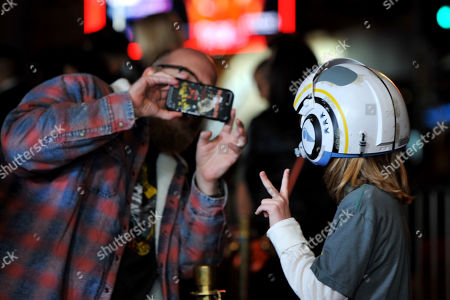 Stock Image of Brian Posehn (L) takes a photo of his guest as he arrives at the premiere of the Disney Plus web television series 'The Mandalorian' at El Capitan Theatre in Los Angeles, California, USA, 13 November 2019.