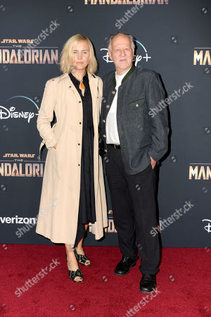 Werner Herzog (R) and Russian-American visual artist Lena Herzog (L) arrive at the premiere of the Disney Plus web television series 'The Mandalorian' at El Capitan Theatre in Los Angeles, California, USA, 13 November 2019.