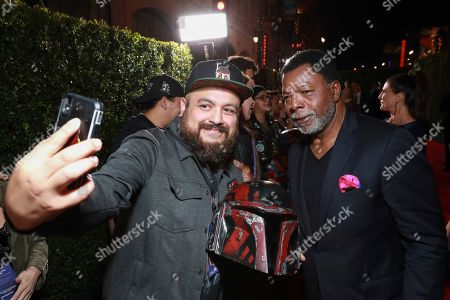 "Carl Weathers, right, poses for a photo on the red carpet as he attends the LA Premiere of ""The Mandalorian"" at the El Capitan Theatre, in Los Angeles"