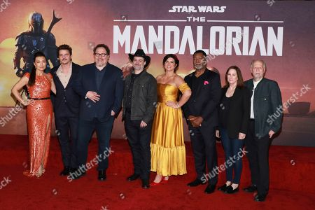 "Ming-Na Wen, Pedro Pascal, Jon Favreau, Dave Filoni, Gina Carano, Carl Weathers, Kathleen Kennedy, Werner Herzog. Ming-Na Wen, from left, Pedro Pascal, Jon Favreau, Dave Filoni, Gina Carano, Carl Weathers, Kathleen Kennedy, and Werner Herzog attend the LA Premiere of ""The Mandalorian"" at the El Capitan Theatre, in Los Angeles"