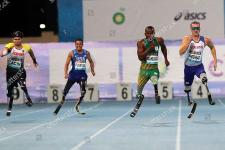 (L-R) Ali Lacin of Germany, Luis Puertas of USA, Ntando Mahlangu of South Africa and Richard Whitehead of Great Britain competes in the Men?s 200m T61 at the World Para Athletics Championships in Dubai, United Arab Emirates, 14 November 2019.