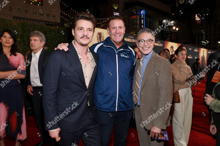 """Pedro Pascal, Kevin Mayer, Ricky Strauss. Pedro Pascal, from left, Kevin Mayer, and Ricky Strauss attend the LA Premiere of """"The Mandalorian"""" at the El Capitan theatre on in Los Angeles"""