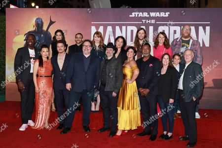 "Rick Famuyiwa, Ming-Na Wen, Julia Jones, Pedro Pascal, Omid Abtahi, Jon Favreau, Bryce Dallas Howard, Dave Filoni, Deborah Chow, Gina Carano, Ludwig Goransson, Carl Wethers,Emily Swallow, Kathleen Kennedy, Aidan Bertola, Brian Posehn, Werner Herzog. Rick Famuyiwa, from left, Ming-Na Wen, Julia Jones, Pedro Pascal, Omid Abtahi, Jon Favreau, Bryce Dallas Howard, Dave Filoni, Deborah Chow, Gina Carano, Ludwig Goransson, Carl Wethers,Emily Swallow, Kathleen Kennedy, Aidan Bertola, Brian Posehn, and Werner Herzog attend the LA Premiere of ""The Mandalorian"" at the El Capitan theatre on in Los Angeles"