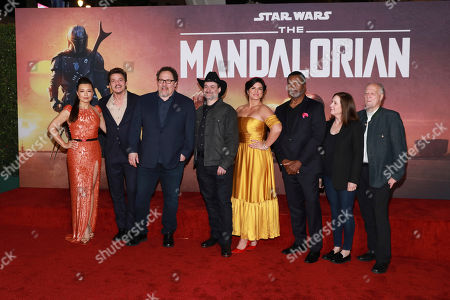 "Ming-Na Wen, Pedro Pascal, Jon Favreau, Dave Filoni, Gina Carano, Carl Wethers, Kathleen Kennedy, Werner Herzog. Ming-Na Wen, from left, Pedro Pascal, Jon Favreau, Dave Filoni, Gina Carano, Carl Wethers, Kathleen Kennedy, Werner Herzog attend the LA Premiere of ""The Mandalorian"" at the El Capitan theatre on in Los Angeles"