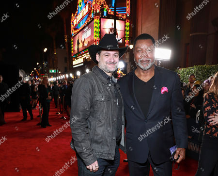 "Dave Filoni, Carl Weathers. Dave Filoni and Carl Weathers attends the LA Premiere of ""The Mandalorian"" at the El Capitan theatre on in Los Angeles"