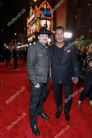 "Stock Picture of Dave Filoni, Carl Weathers. Dave Filoni and Carl Weathers attends the LA Premiere of ""The Mandalorian"" at the El Capitan theatre on in Los Angeles"