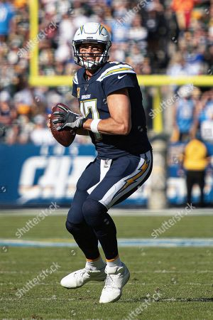 Los Angeles Chargers quarterback Philip Rivers looks to throw a pass in an NFL football game against the Green Bay Packers in Carson, Calif