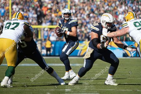 Stock Picture of Los Angeles Chargers quarterback Philip Rivers, center, looks to throw a pass in an NFL football game against the Green Bay Packers in Carson, Calif