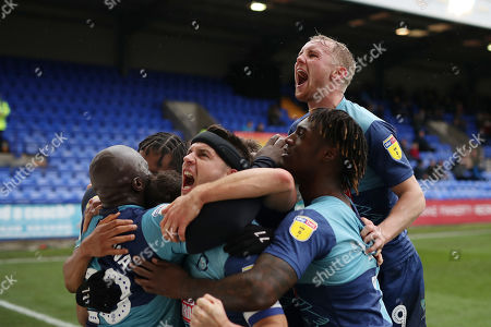 Stock Photo of Adebayo Akinfenwa of Wycombe Wanderers celebrates scoring his sides first goal with team mates