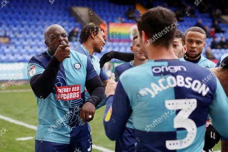 Adebayo Akinfenwa of Wycombe Wanderers celebrates scoring his sides first goal