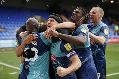 Wycombe Wanderers players celebrate the first goal scored by Adebayo Akinfenwa scoring his sides first goal