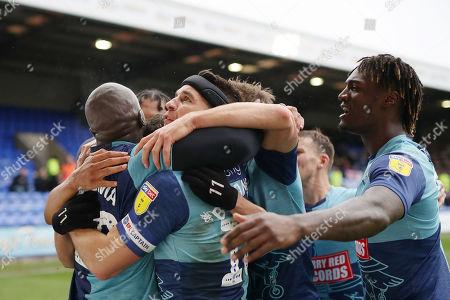 Wycombe Wanderers celebrate the first goal scored by Adebayo Akinfenwa
