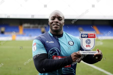 Adebayo Akinfenwa of Wycombe Wanderers with his man of the match trophy