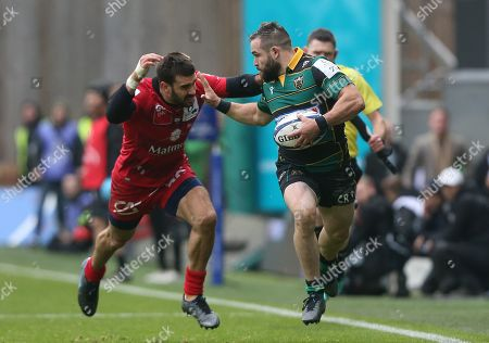 Stock Image of Northampton Saints Jacobus Reinach is tackled by Lyon ou's Pato Fernandez