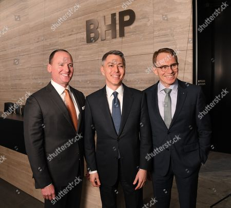 Stock Photo of (L-R) BHP Chairman Ken MacKenzie, BHP CEO-Elect Mike Henry and BHP chief executive Andrew Mackenzie pose for a photo following a press conference at BHP headquarters in Melbourne, Victoria, Australia, 14 November 2019. BHP chief executive Andrew Mackenzie will retire as boss of the world's biggest miner at the end of 2019, when insider Mike Henry will take the reins.