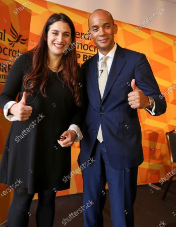 Luciana Berger and Chuka Umunna pose for the camera after their speeches at Glaziers Hall