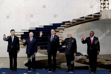 From left to right, China's President Xi Jinping, Russia's President Vladimir Putin, Brazil's President Jair Bolsonaro, India's Prime Minister Narendra Modi and South Africa's President Cyril Ramaphosa pose for the family photo of leaders of the BRICS emerging economies at the Itamaraty palace in Brasilia, Brazil