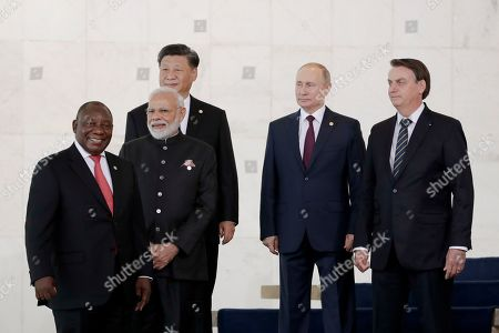 From left to right, South Africa's President Cyril Ramaphosa, India's Prime Minister Narendra Modi, China's President Xi Jinping, Russia's President Vladimir Putin and Brazil's President Jair Bolsonaro stand prior to the group photo during the BRICS emerging economies summit at the Itamaraty palace in Brasilia, Brazil