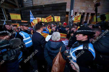Former Catalan education minister Clara Ponsati (C-R) and her lawyer Aamer Anwar (C-L) leave Edinburgh Sheriff Court in Edinburgh, Britain, 14 November 2019.  Ponsati was granted bail and allowed to keep her passport, according to media reports.