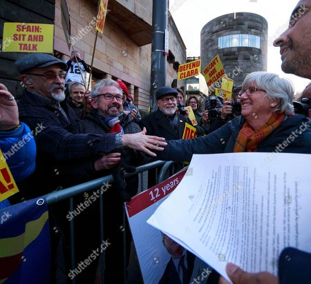 Former Catalan Education Minister Clara (2-R) Ponsati and her lawyer Aamer Anwar (R) leave Edinburgh Sheriff Court in Edinburgh, Britain, 14 November 2019. Ponsanti was granted bail and allowed to keep her passport, according to medai reports.