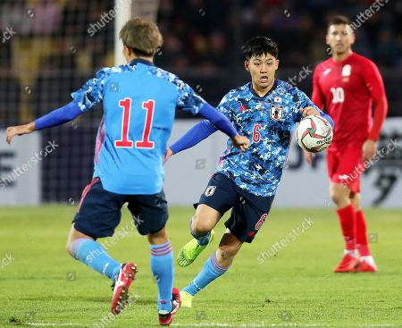 Stock Photo of Wataru Endo (C) of Japan in action during the FIFA World Cup 2022 qualifying soccer match between Kyrgyzstan and Japan at the Spartak stadium in Bishkek, Kyrgyzstan, 14 November 2019.