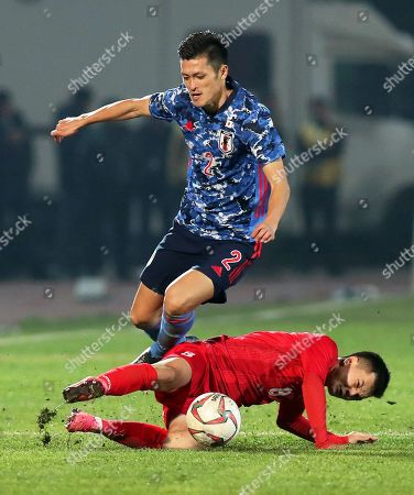 Kyrgyzstan's Gulzhigit Alykulov (R) in action against Naomichi Ueda (L) of Japan during the FIFA World Cup 2022 qualifying soccer match between Kyrgyzstan and Japan at the Spartak stadium in Bishkek, Kyrgyzstan, 14 November 2019.