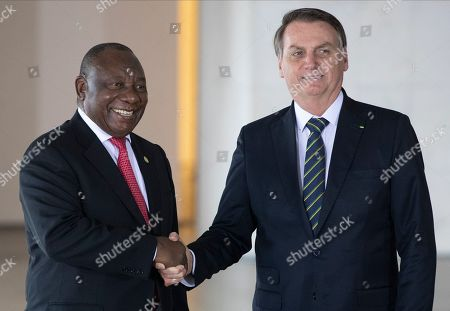 Brazil's President Jair Bolsonaro, right, and South Africa's President Cyril Ramaphosa pose for a photo prior to a meeting of leaders of the BRICS emerging economies at the Itamaraty palace in Brasilia, Brazil