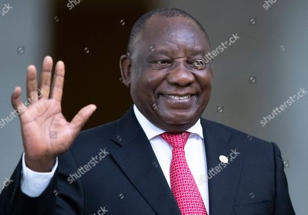 South Africa's President Cyril Ramaphosa greets the media prior to a meeting of leaders of the BRICS emerging economies at the Itamaraty palace in Brasilia, Brazil